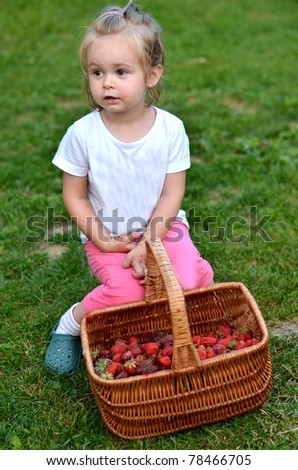 baby with strawberries