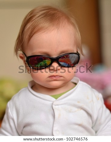 baby with sunglasses - stock photo
