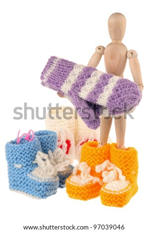 Baby wool socks and mannequin isolated on white background