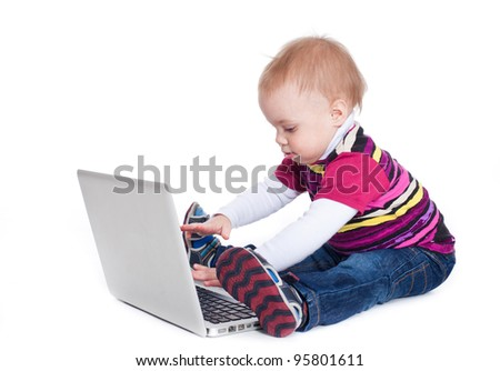 Baby working on computer typing