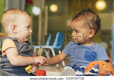 Babys playing together in the kindergarten.