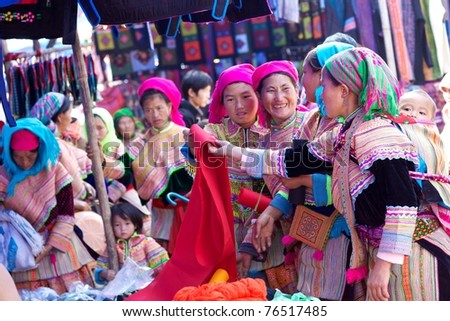BAC HA, VIETNAM - NOV 21: Unidentified girls of the Flower H'mong Ethnic Minority People at market on November 21, 2010 in Bac Ha, Vietnam. H'mong are the 8th largest ethnic group in Vietnam