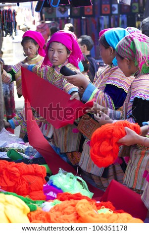 BAC HA, VIETNAM - NOV 21: Unidentified women of the Flower H'mong Ethnic Minority People at market on November 21, 2010 in Bac Ha, Vietnam. H'mong are the 8th largest ethnic group in Vietnam