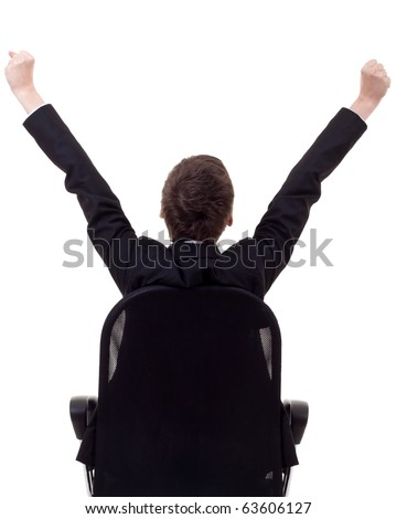 bac picture of a business woman sitting in a chair and with her hands in the air celebrating success