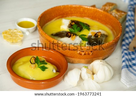 Bacalao al pil pil traditional tapa from north Spain. Codfish cooked with a delicious sauce made with oil, codfish and garlic. Stock photo ©