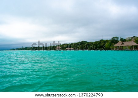 Bacalar Lake Lagoon in Mexico. Crystal Clear Blue and Green Water.  #1370224790