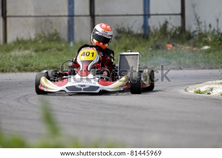 BACAU, ROMANIA - JULY 17: David Dugaesescu, number 401, competes in National Karting Championship, Round 3, on July 17, 2011 in Bacau, Romania.