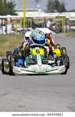 BACAU, ROMANIA - SEPTEMBER 4: Tudor Pitulea, number 6, competes in National Karting Championship, Round 6, on September 4, 2011 in Bacau, Romania.