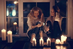 bachelorette party, two girls girlfriends drinking wine and relaxing at home