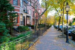 Back Bay Boston in the Fall - Red brick sidewalk and brownstones, iron fence and street lamps