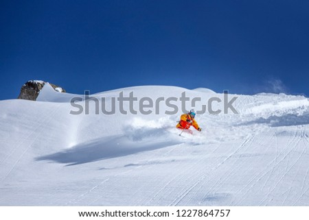 back country skiing in fresh powder snow #1227864757