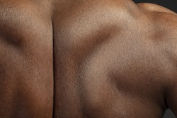 Back. Detailed texture of human skin. Close up shot of young african-american male body. Skincare, bodycare, healthcare, hygiene and medicine concept. Looks beauty and well-kept. Dermatology.