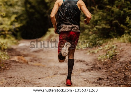 c660355675 back dirty man runner in compression socks running on spring trail