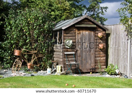 Back garden shed with old metal bicycle