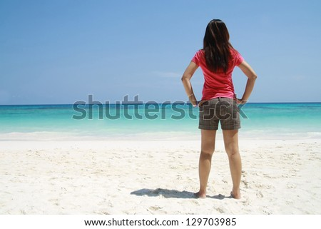 back happy asian woman stand on beach , beautiful sand surface background ,travel landscape clean white sand beach and blue sea water wave ripple background, beautiful ocean and natural island #129703985