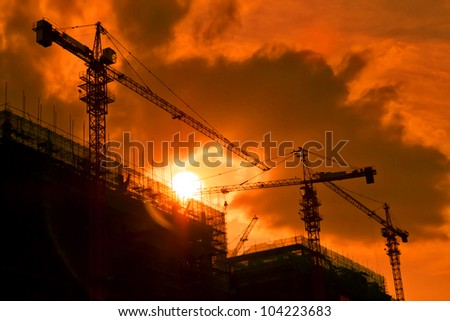 back light construction site silhouetted at sunset