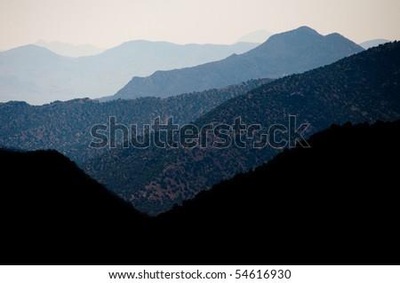 back lit blue layers of Coronado National Forest mountain range