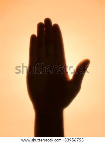 Back-lit hand signaling 'stop'