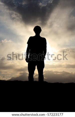 Back lit man before dramatic cloudy sky #57223177