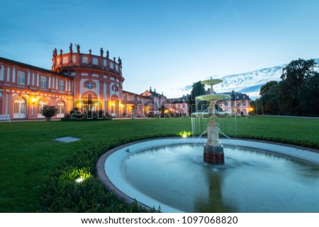 Back of Biebrich Castle in the German city of Wiesbaden with water fountain at dusk