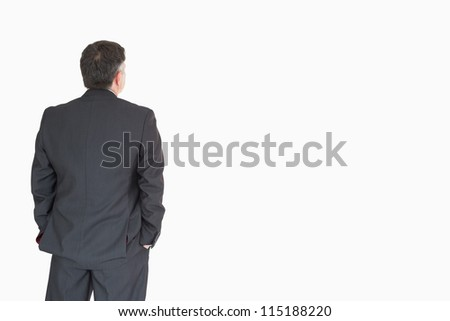 Back of businessman with hands in pockets