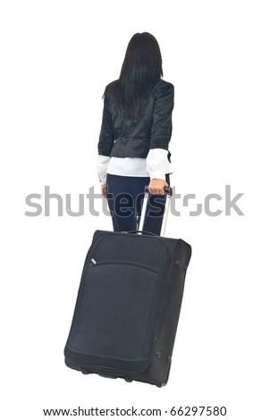 Back of businesswoman or stewardess going in a travel and carry luggage isolated on white background