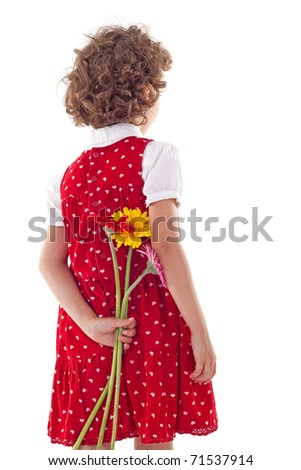 Back of cute little girl in red dress, hiding flowers for mother's day, isolated