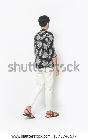 Back of Full body Summer man casual wearing new stylish fern leaves printed long ,sleeves shirt with white pants and brown shoes,walking in studio