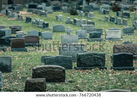 Back of Gravestones in a Old Cemetery during Cold day of Autumn ストックフォト ©