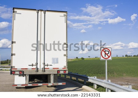 Back of  parked, white Semi-Truck
