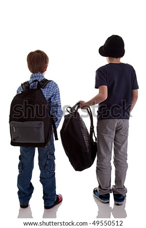 Back of schoolboy holding backpack