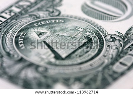 back of the one dollar bill: the pyramid, shallow depth of field