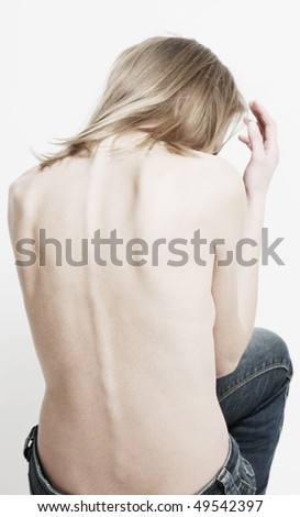 back of thin young woman