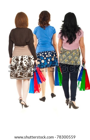 Back of three women walking at shopping isolated on white background