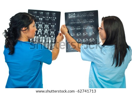 Back of two doctors women compare results of MRI and having conversation isolated on white background