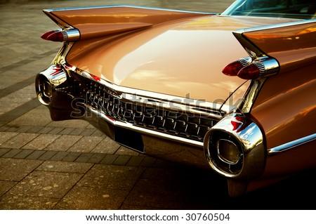 back of vintage car in sepia...