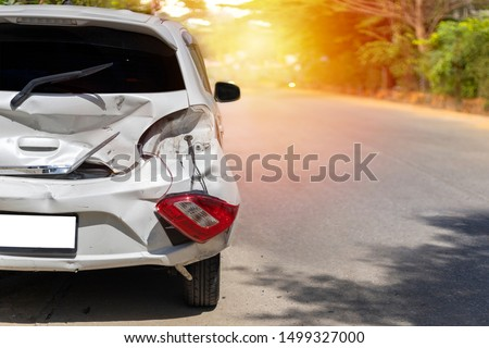 Back of white color car have big damaged and broken by accident on road in morning time can not drive any more park for wait insurance officer. With copy space for text or design #1499327000