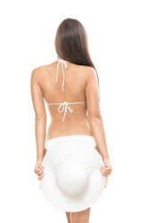 Back of young beautiful woman brunette isolated on white background wearing summer beach hat and bikini.