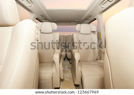 Back passenger seats in luxury MPV car, frontal view - stock photo
