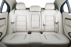 Back passenger seats in modern luxury car, frontal view, white leather