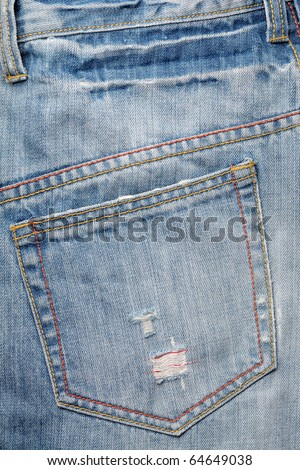 back pocket of blue jeans trouser with colorful seam and scratch - stock photo