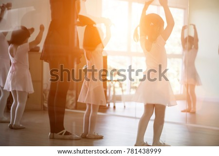 back shot of kid practice ballet dance in studio in morning light #781438999