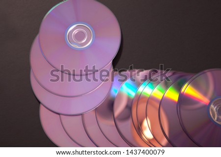 back side of several compact discs or cds, old technology