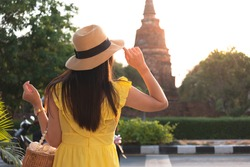 Back side of Young Asian traveling, women walking during summer vacation in famous asian destination, Carefree girl tourist. traveler and tourist concept, Finding solitude in the wilderness.