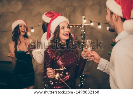 Back side portrait of cheerful ladies celebrate xmas with her sweetheart and fellows wear cap hat cheers hold champagne give toast in newyear christmas decorative interior indoors