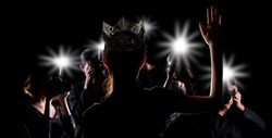 Back side view of Miss Pageant beauty contest with Silver Diamond Crown wave hand to many Photographers who shoot photo image to celebrity at red carpet event, and flash fire light came out copy space