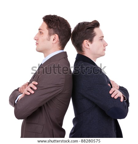 back to back businessmen looking away from the camera over white background