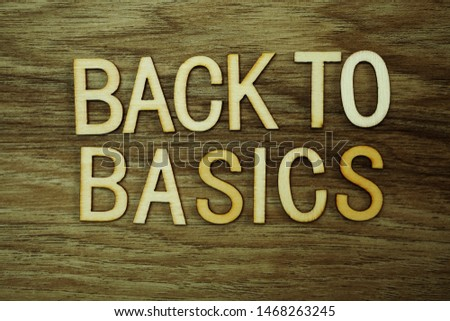 Back To Basics text message on wooden background