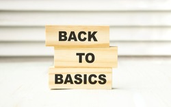 back to basics word written on wood block. back to basics text on table, concept.
