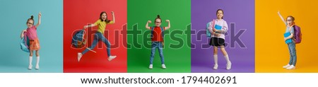 Back to school and happy time! Collage of five children on colorful paper wall background. Kids with backpack. Girls glad ready to study. Foto stock ©